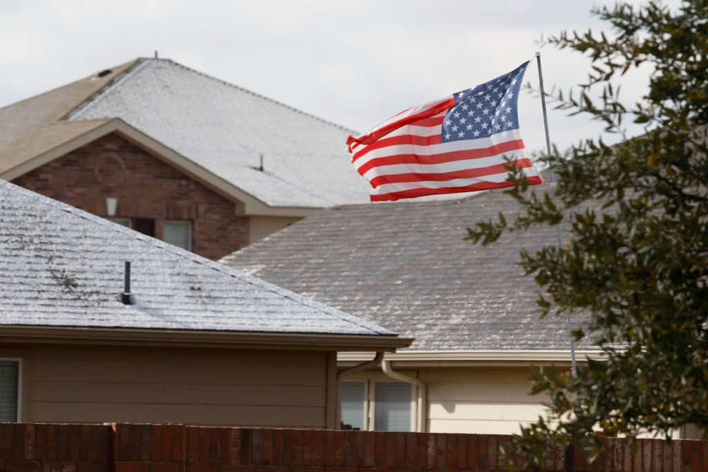 Strong winds blow through after an overnight storm left a thin layer of snow and ice on rooftops in McKinney on Saturday, Jan. 19, 2019.