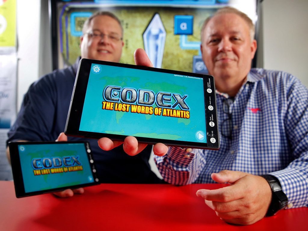 Southern Methodist University  professors Corey Clark (left) and Tony Cuevas were part of the SMU-LIFT team, PeopleforWords, that won $1.5 million as a grand prize winner for a video game app, Codex: The Lost Words of Atlantis. The two are photographed in a lab on campus, Wednesday, July 10, 2019.