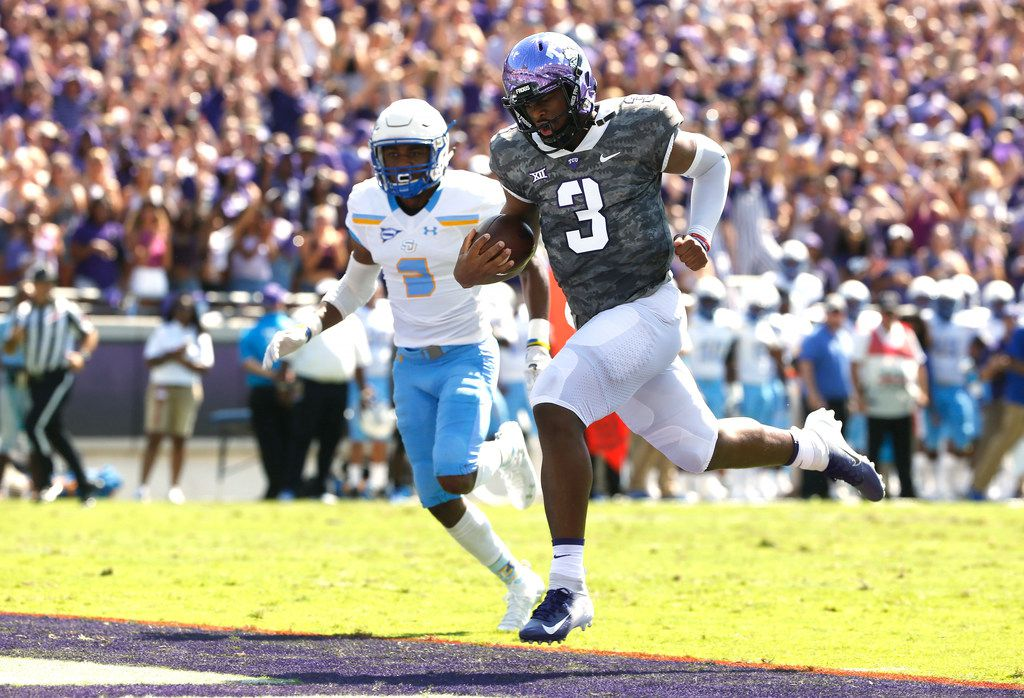 TCU quarterback Shawn Robinson (3) crosses the goal line, scoring on a 36-yard touchdown run, as Southern University defensive back Timothy Thompson (2) looks on during the first half of an NCAA college football game Saturday, Sept. 1, 2018, in Fort Worth, Texas. (AP Photo/Ron Jenkins)