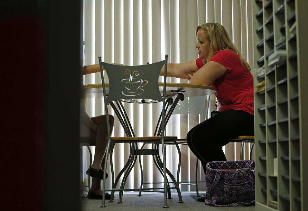 Tarrant County CPS child-abuse investigator Kelli Bailey interviews a possible child abuse victim (left) in Fort Worth, Texas June 21, 2016.  (Nathan Hunsinger/The Dallas Morning News)