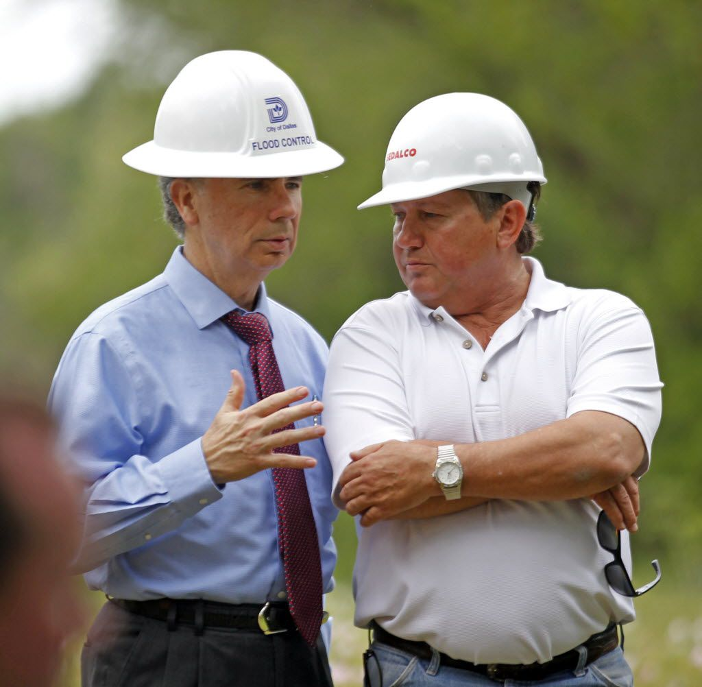 Then-City Manager A.C. Gonzalez talked to  Wayne Kirk (right) as City Council members toured the Texas Horse Park in May 2014.