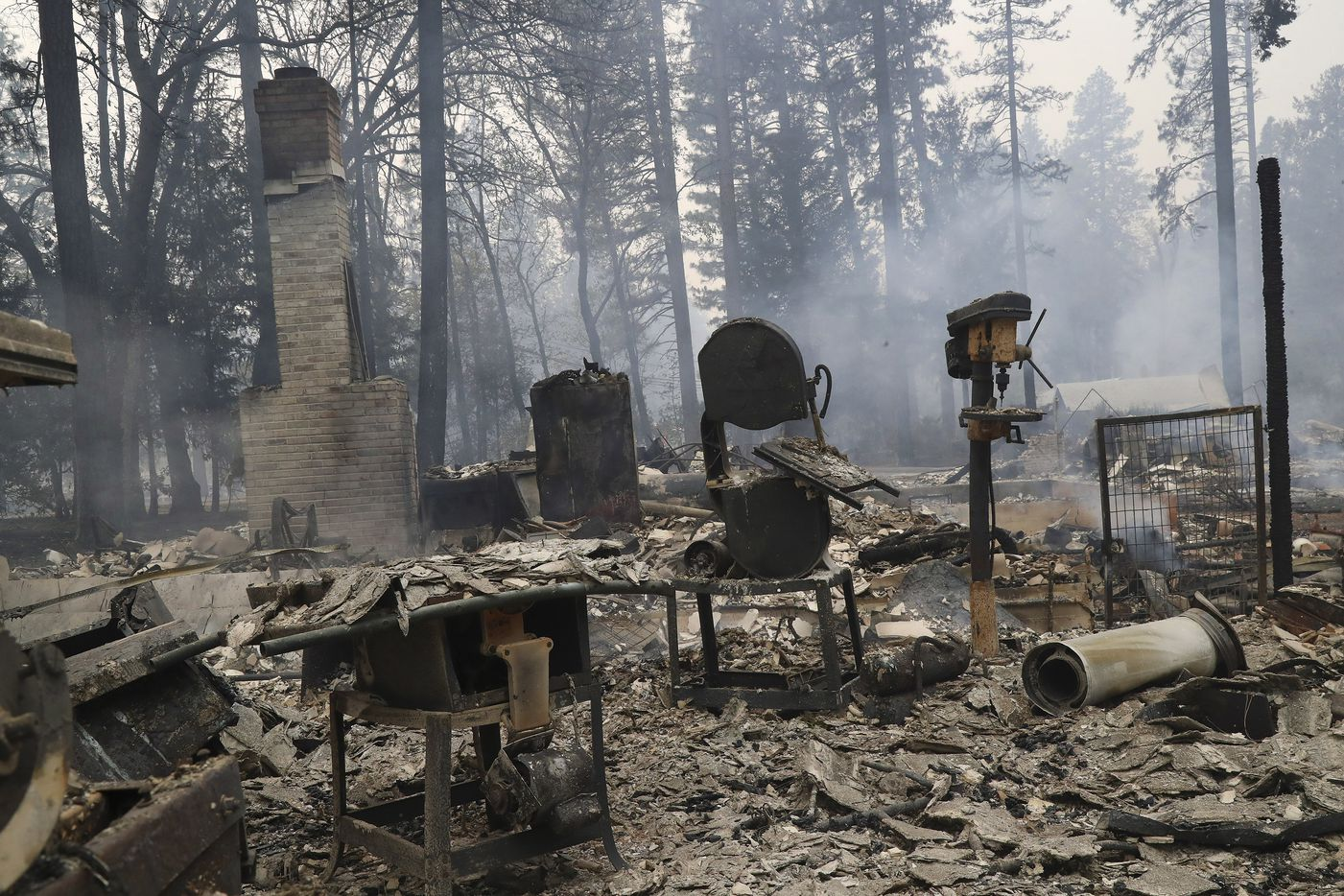 Remains of a home in Paradise, Calif., after the Camp Fire tore through the town, Nov. 9, 2018. Of the 23 people known on Nov. 11 to have been killed by the fire in Paradise, six had died in their cars.