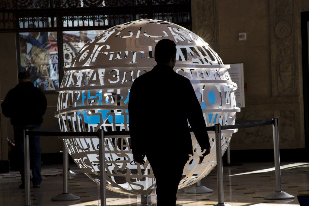 A customer walks past a statue during the grand opening of the AT&T Corp. west coast flagship store in San Francisco, California, U.S., on Wednesday, Sept. 28, 2016. AT&T Corp. spent in excess of $10 million over a course of 2 years to renovate, rebuild and connect the 20,000 square foot space in the 108 year old building into the company's largest store in the country. Photographer: David Paul Morris/Bloomberg