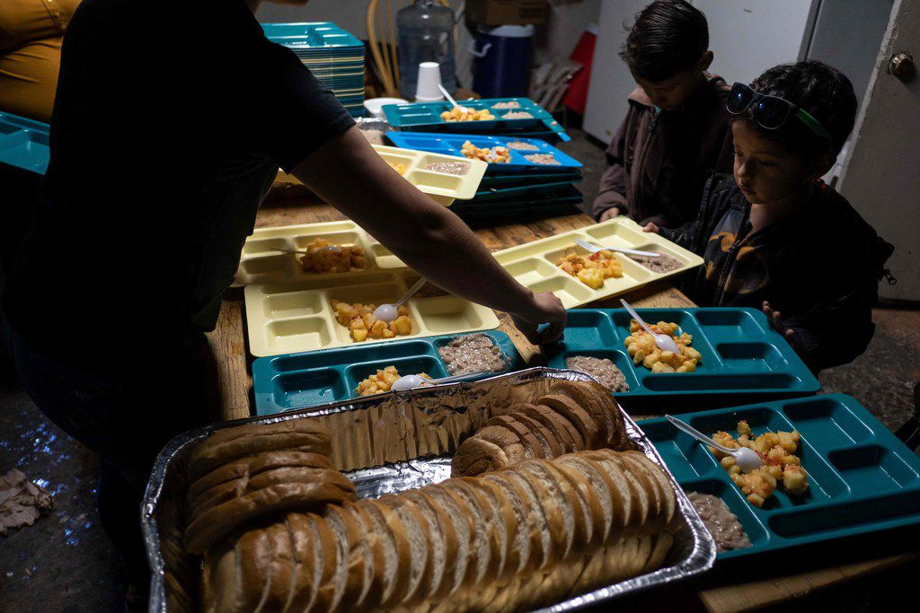 Minor migrants seeking for asylum in the United States pick their food trays in Juventud 2000 migrant shelter in Tijuana, on March 5, 2019. - According to the US Customs and Border Protection, statistics observed more than a 300 percent increase in the number of family units apprehended compared to the same time period in 2018. (Photo by Guillermo Arias / AFP)GUILLERMO ARIAS/AFP/Getty Images
