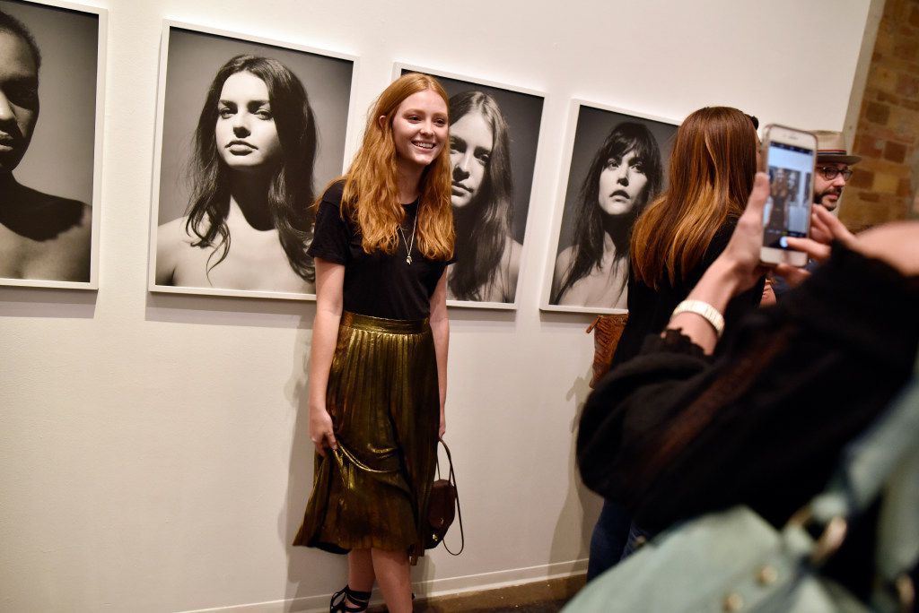 Model Haley Halter is photographed by her mother Laurel Halter next to her image by Fredrik Broden during opening night of his exhibit.
