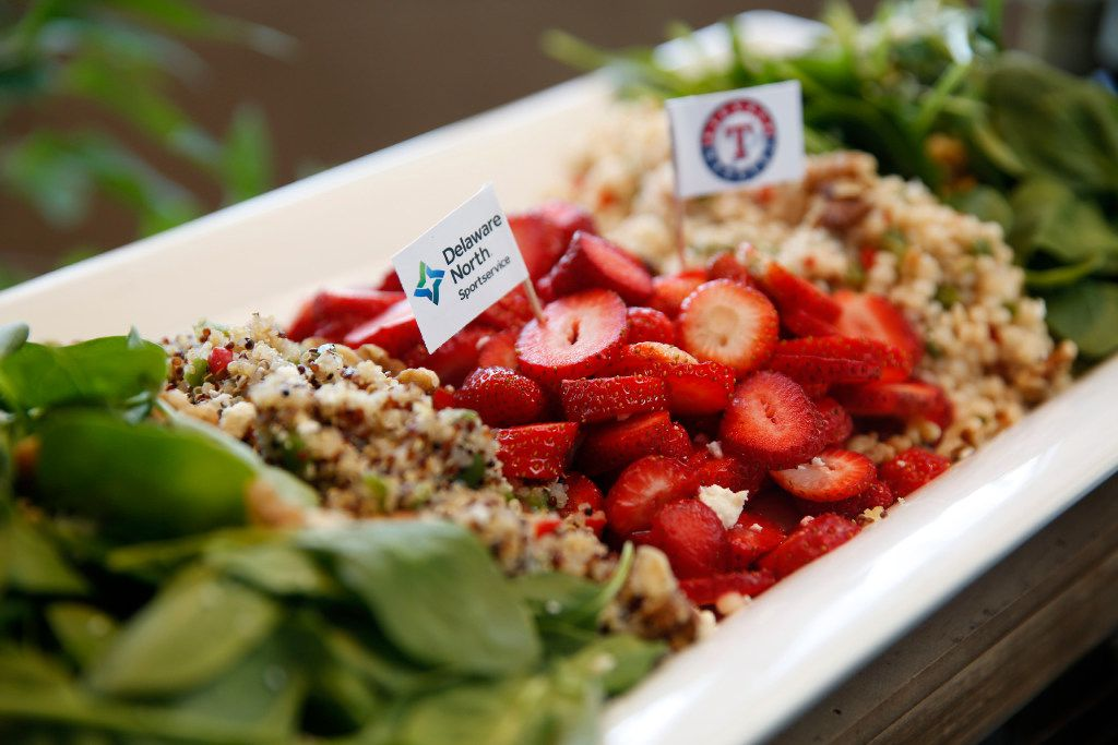 This healthy Globe Life Park salad features strawberries, quinoa, baby spinach and toasted walnuts.
