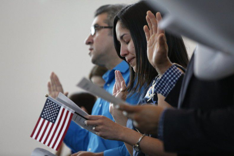 Surrounded by strangers, soon to be fellow Americans. (Rose Baca/The Dallas Morning News)