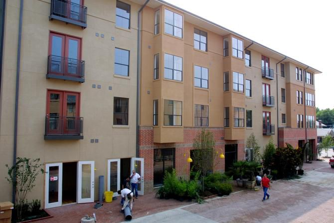 Workers put the finishing touches on the Eastside Village Phase II apartments in downtown Plano in 2002. The building is now one of a number of housing options for residents looking to live in the city's urban core.
