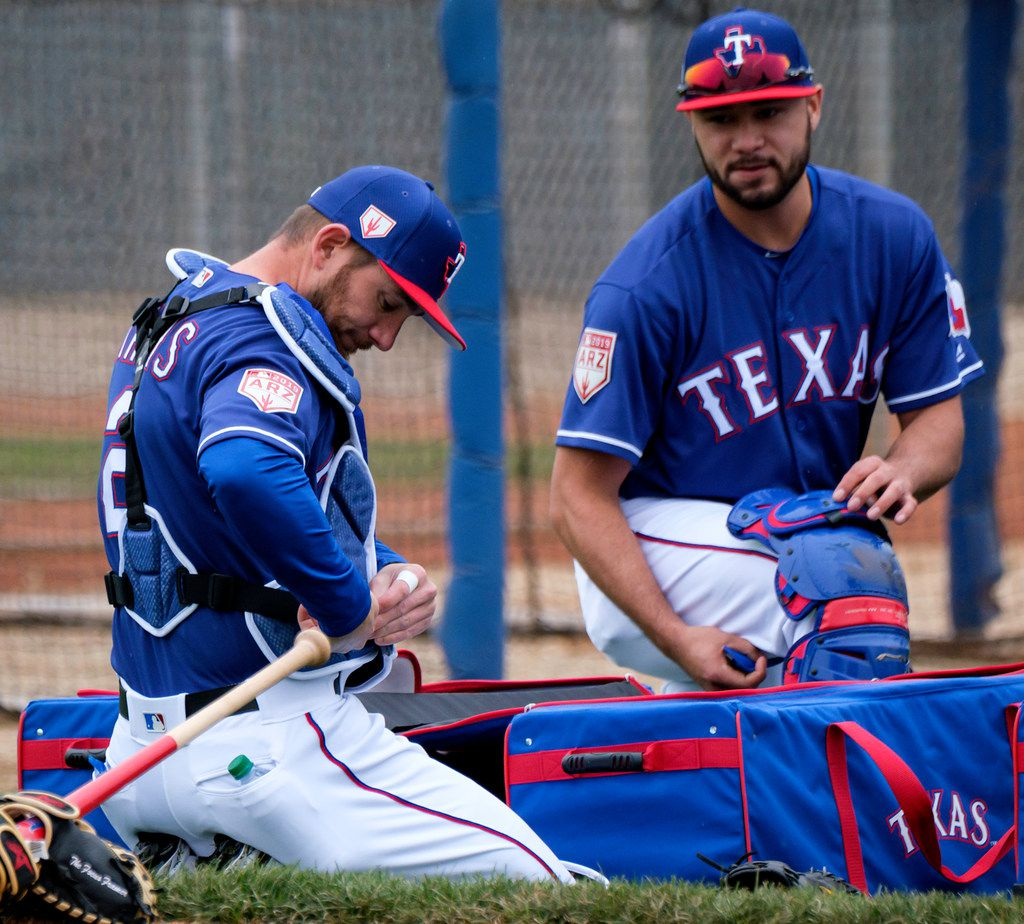 Texas Rangers catchers Isiah Kiner-Falefa (right) and Jeff Mathis prepare to catch a bullpen session during a spring training workout at the team's training facility on Thursday, Feb. 14, 2019, in Surprise, Ariz.. (Smiley N. Pool/The Dallas Morning News)
