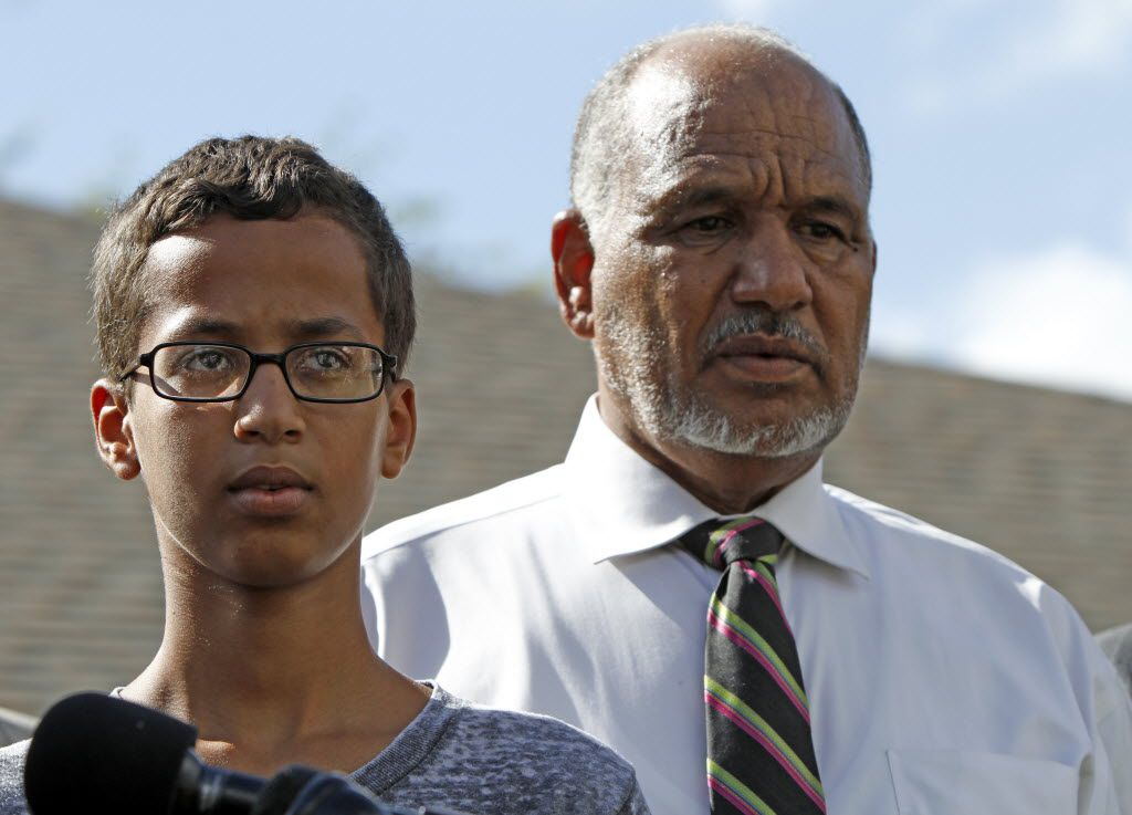Ahmed Mohamed stands with his father Mohamed Elhassan Mohamed during a news conference on September 16, 2015 in Irving, Texas. The news converence, held outside the Mohammed family home, was hosted by the North Texas Chapter of the Council on American-Islamic Relations.