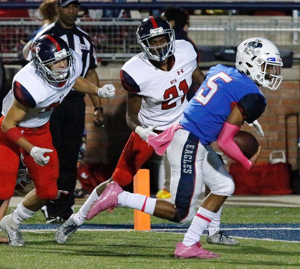 Allen High School quarterback Raylen Sharpe (5) runs past McKinney Boyd High School cornerback Naaman Roberson (21) to score a touchdown during the second half as Allen High School hosted McKinney Boyd High School at Eagle Stadium in Allen on Friday night, October 26, 2018.  (Stewart F. House/Special Contributor)