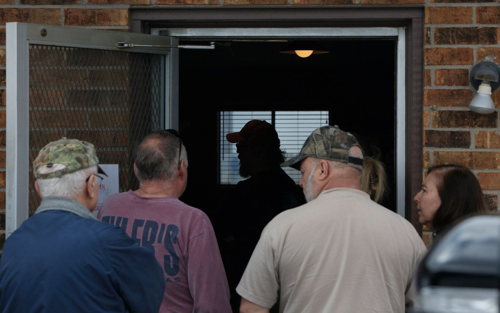 Glen Sanders, of Covington, is silhouetted by window light from inside the restaurant as other local supporters stand in line outside of Flores Barbecue for a final taste of their barbecue during their final weekend before closing the business. The popular restaurant is moving to Fort Worth where they will initially re-open the business before moving into a true restaurant in the early summer of 2020. Pitmaster and owner Michael Wyont, along with his staff, served loyal customers at Flores Barbecue in Whitney during their final weekend of business. Some of his loyal customers waited up to an hour in line for his famous barbecue and share their well wishes on Saturday February 2, 2019 (Steve Hamm/ Special Contributor)