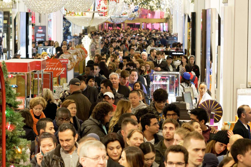 Shoppers crowd the aisles in Macys department store in Herald Square, New York, on November 26, 2015.