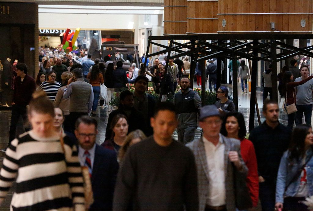 People walking in the NorthPark Center in Dallas on Nov. 23, 2018. (Nathan Hunsinger/The Dallas Morning News)