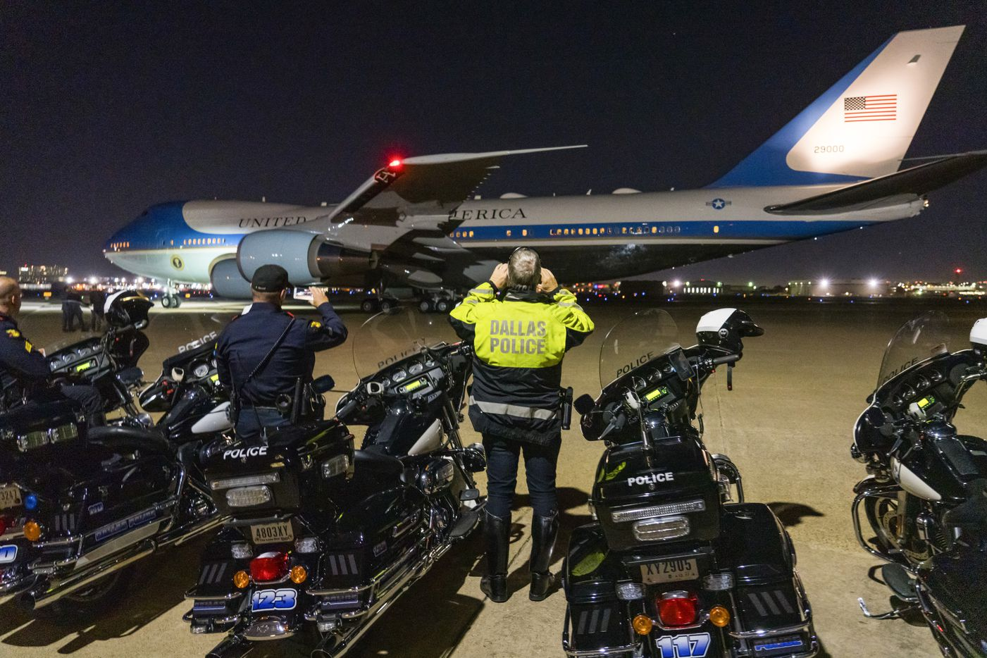 Dallas Police take photos of Air Force One as it departs Love Field after President Donald Trump visited Dallas campaign rally at the American Airlines Center on Thursday, Oct. 17, 2019, in Dallas.