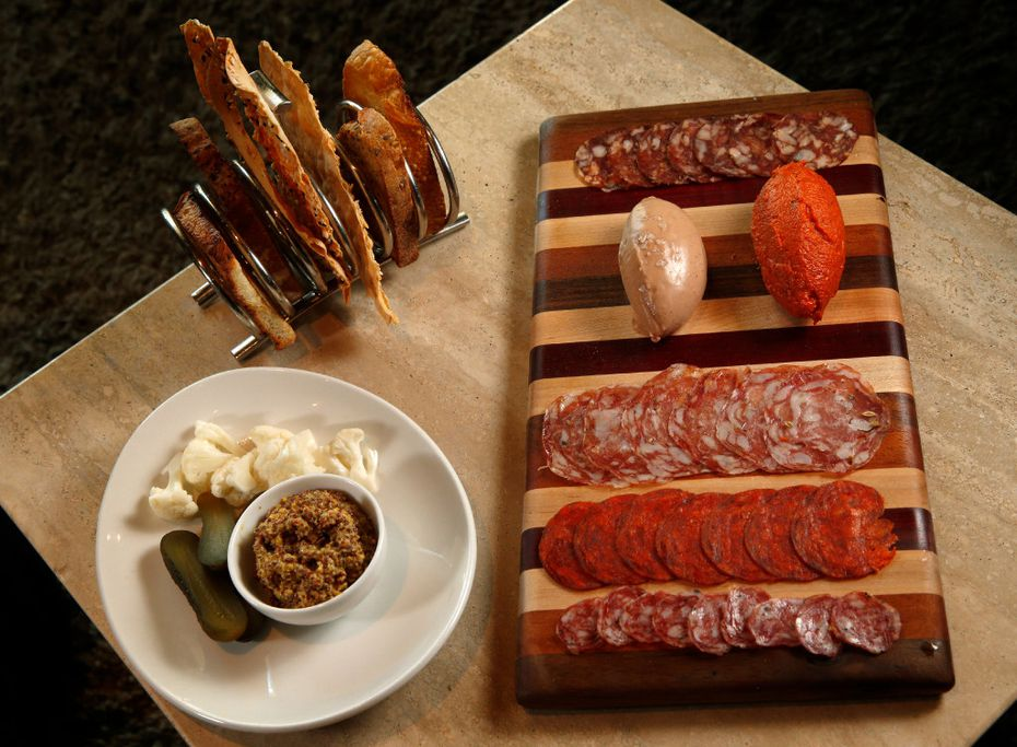 A charcuterie board at Knife Dallas. The nduja is the dark-red football-shaped spreadable meat.