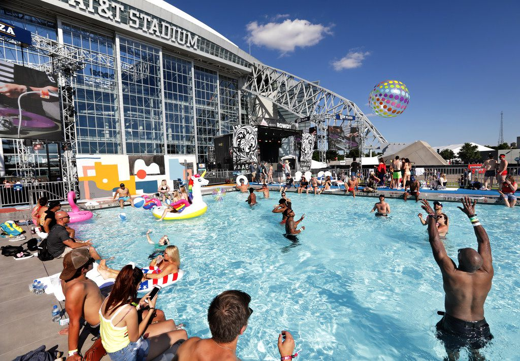 Guests enjoy the pool as Mix Master Mike performs during Kaaboo Texas at AT&T Stadium in Arlington, on May 12, 2019.