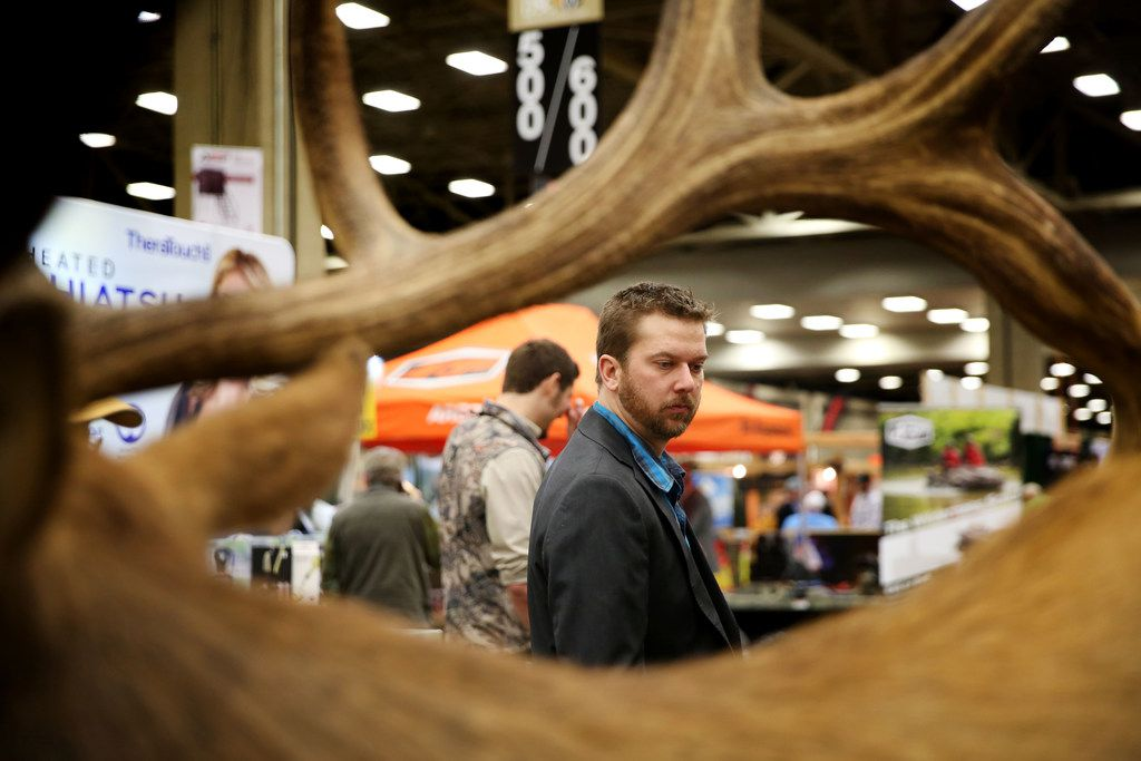 Ryan Plett looks at taxidermy work during the Dallas Safari Club annual convention and sporting expo at the Kay Bailey Hutchison Convention Center in Dallas on Thursday, Jan. 4, 2018.
