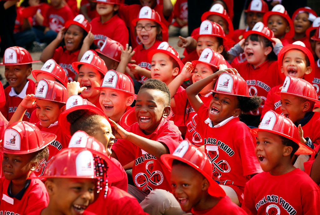 Kids at Frederick Douglass Elementary School in Dallas laugh at the Texas Rangers mascot (not pictured) as they wait to hear from former Texas Rangers third baseman Michael Young on Thursday, April 25, 2019, in Dallas. Young joined Dallas Fire-Rescue and The Hartford insurance company in teaching fire safety and prevention.