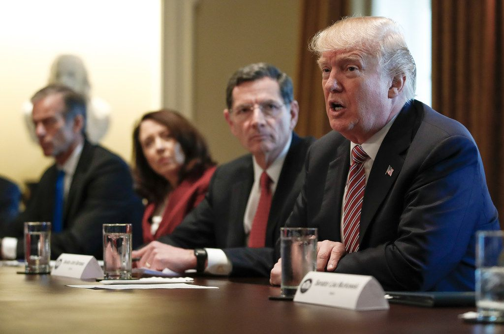 President Donald Trump, joined by, from left, Sen. John Thune, R-S.D., Sen. Maria Cantwell, D-Wash., and Sen. John Barrasso, R-Wyo., speaks to media during a meeting about infrastructure in the Cabinet Room of the White House on Feb. 14, 2018.