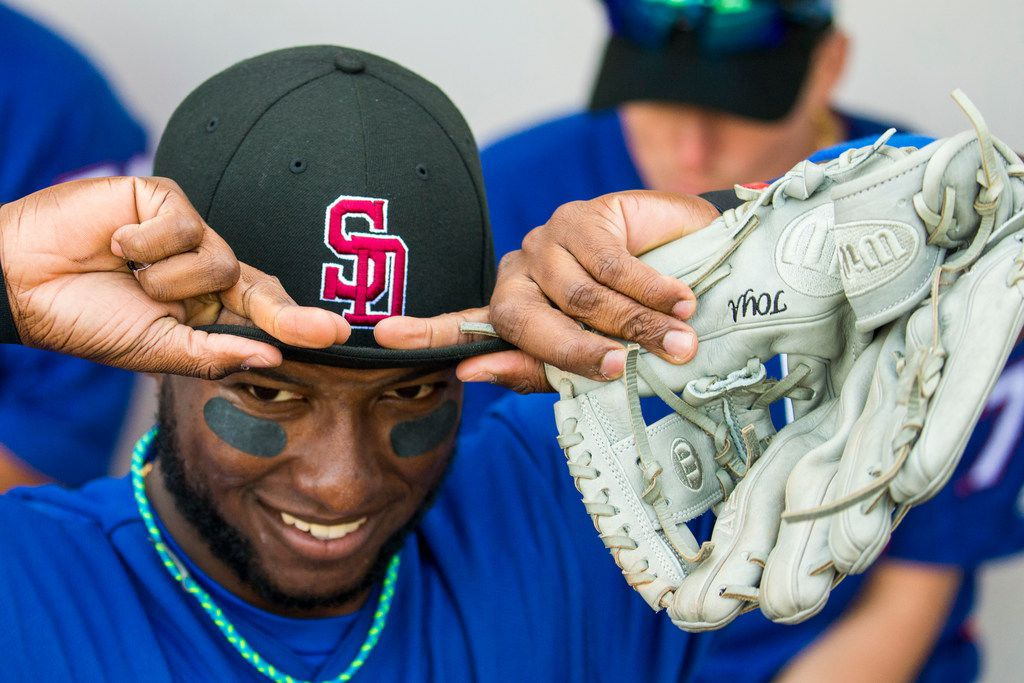 Texas Rangers infielder Jurickson Profar dons a Marjory Stoneman Douglas High School baseball cap in honor of the victims of the school shooting before a spring training baseball game against the Chicago Cubs on Saturday, Feb. 24, 2018, in Mesa, Ariz. (Smiley N. Pool/The Dallas Morning News)