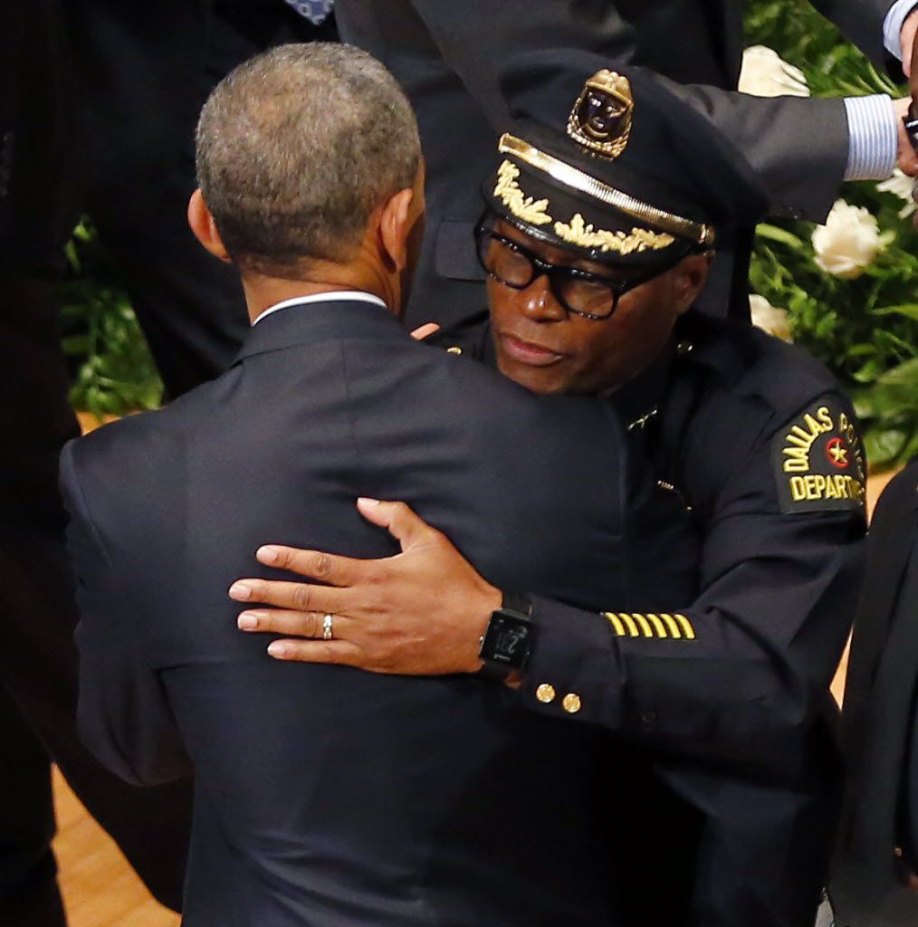 The president and Dallas Police Chief David Brown exchange hugs at Tuesday's memorial.