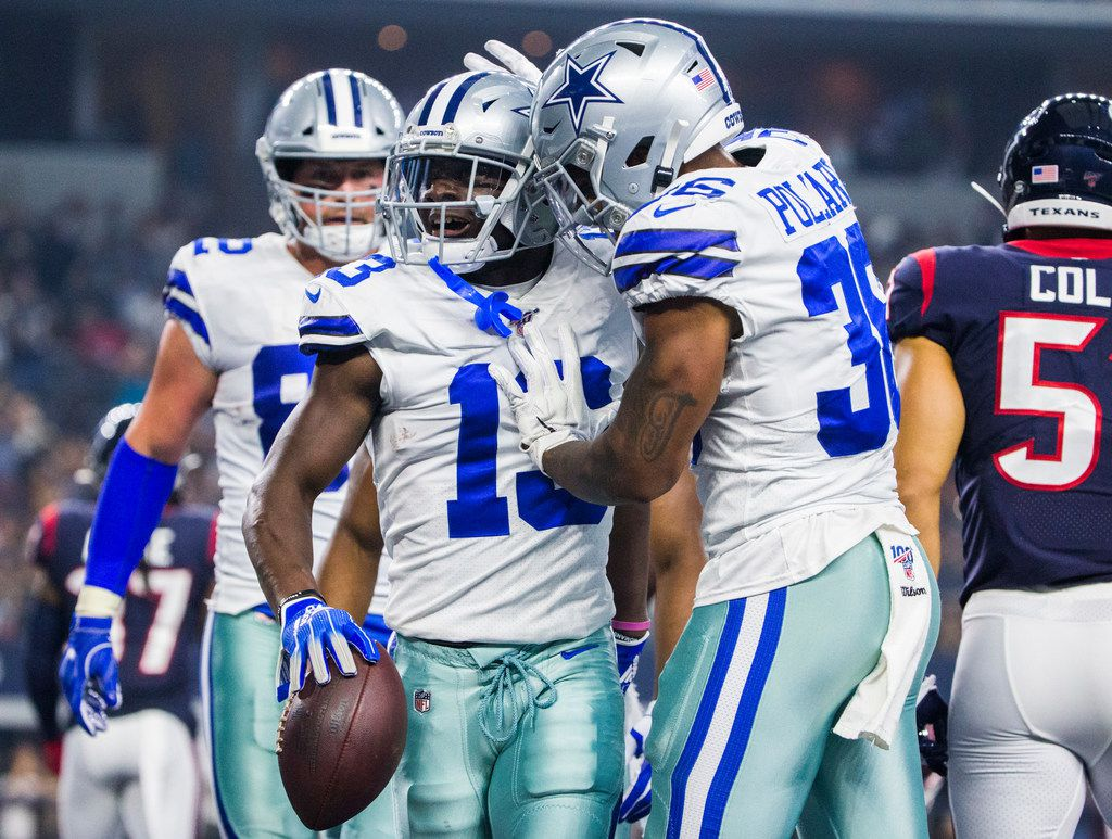 Dallas Cowboys wide receiver Michael Gallup (13) celebrates with running back Tony Pollard (36) after scoring a touchdown during the first quarter of an NFL game between the Dallas Cowboys and the Houston Texans on Saturday, August 24, 2019 at AT&T Stadium in Arlington. (Ashley Landis/The Dallas Morning News)