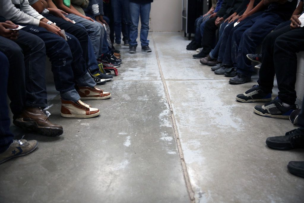 Immigrants caught trying to unlawfully enter the United States waited in detention in McAllen in 2014. (File Photo/The New York Times)