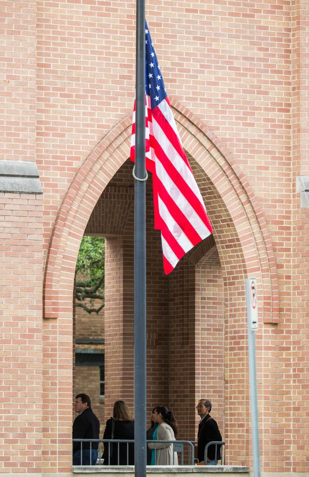 A flag flies at half staff as members of the public arrive to view the casket of former first lady Barbara Bush on Friday, April 20, 2018 at St. Martin's Episcopal Church in Houston. Bush died on Tuesday and her funeral services are on Saturday. (Ashley Landis/The Dallas Morning News)