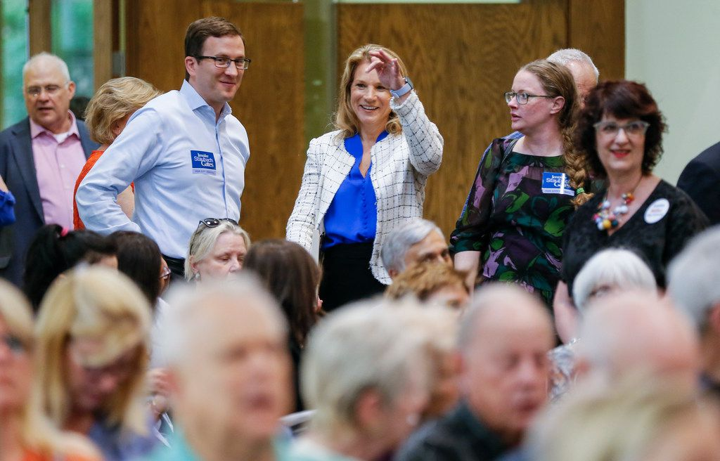 Jennifer Staubach Gates, center, councilwoman for City Council District 13, greets voters before a debate with Laura Miller at Jesuit College Preparatory School of Dallas, Monday, April 22, 2019.