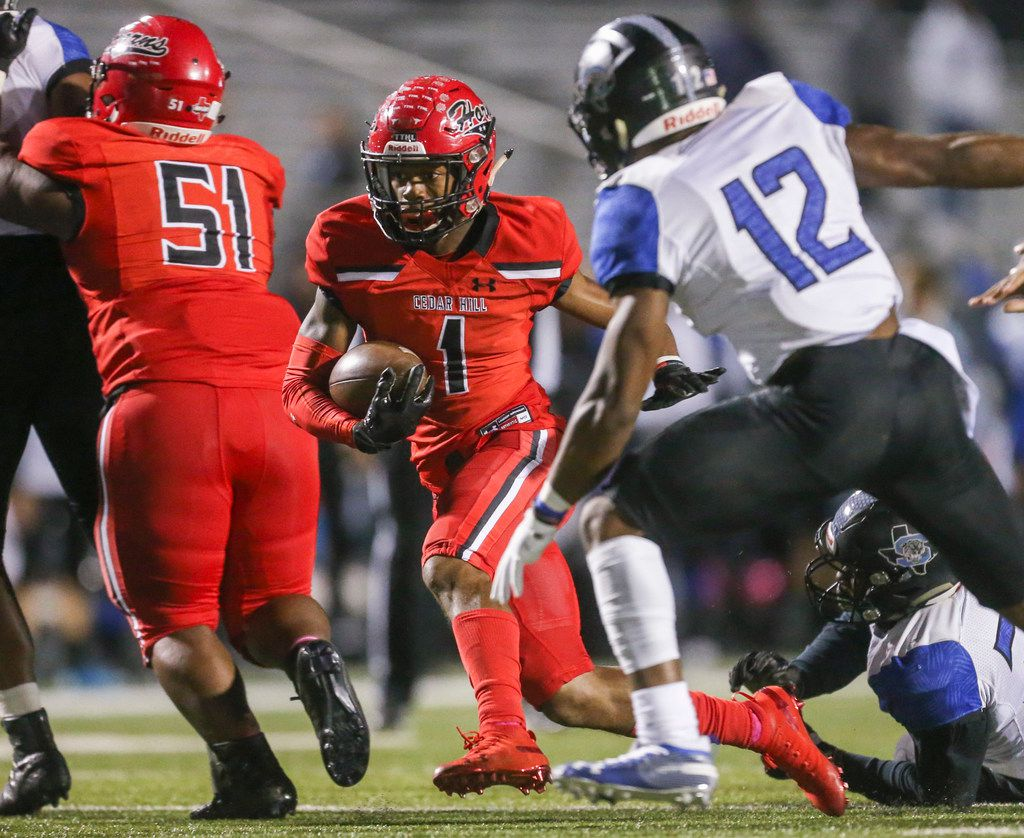 Cedar Hill wide receiver Quin Bright (1) carries the ball past Mansfield Summit linebacker Charles Ezenagu (12) as Cedar Hill Ryan Dehorney (51) blocks for him during the first half of a high school football game between Cedar HIll and Mansfield Summit on Friday, October 11, 2019 at Longhorn Stadium in Cedar Hill, Texas. (Shaban Athuman/Staff Photographer)