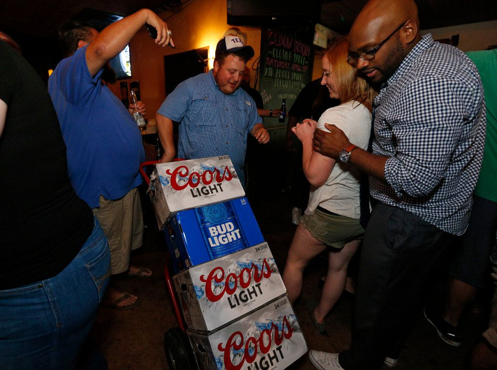 More beer is rolled to the bar during the last hours of operation of the Elbow Room in Dallas on April 16, 2017. (Nathan Hunsinger/The Dallas Morning News)