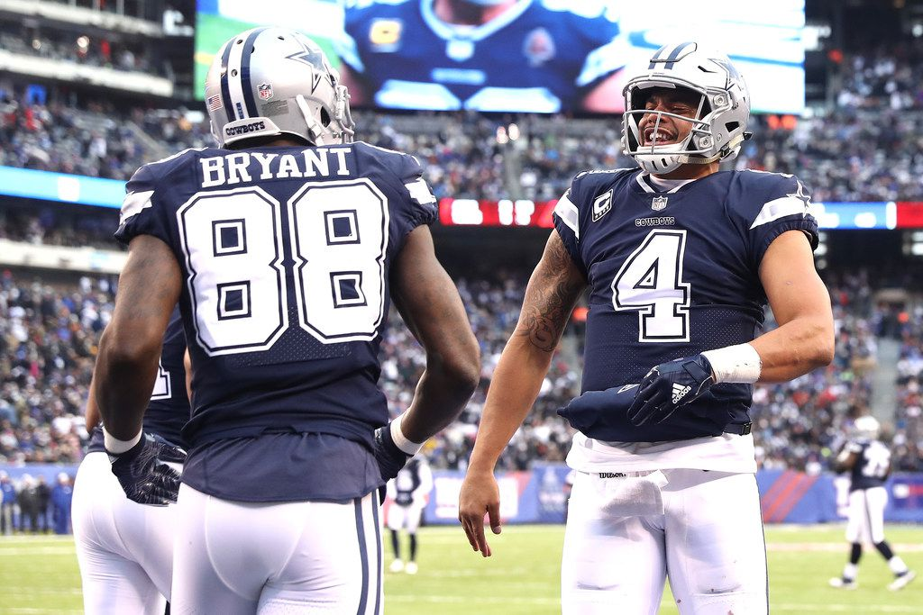 EAST RUTHERFORD, NEW JERSEY - DECEMBER 10:  Dak Prescott #4 of the Dallas Cowboys celebrates a touchdown with Dez Bryant #88 in the fourth quarter against the New York Giants during the game at MetLife Stadium on December 10, 2017 in East Rutherford, New Jersey. (Photo by Elsa/Getty Images)