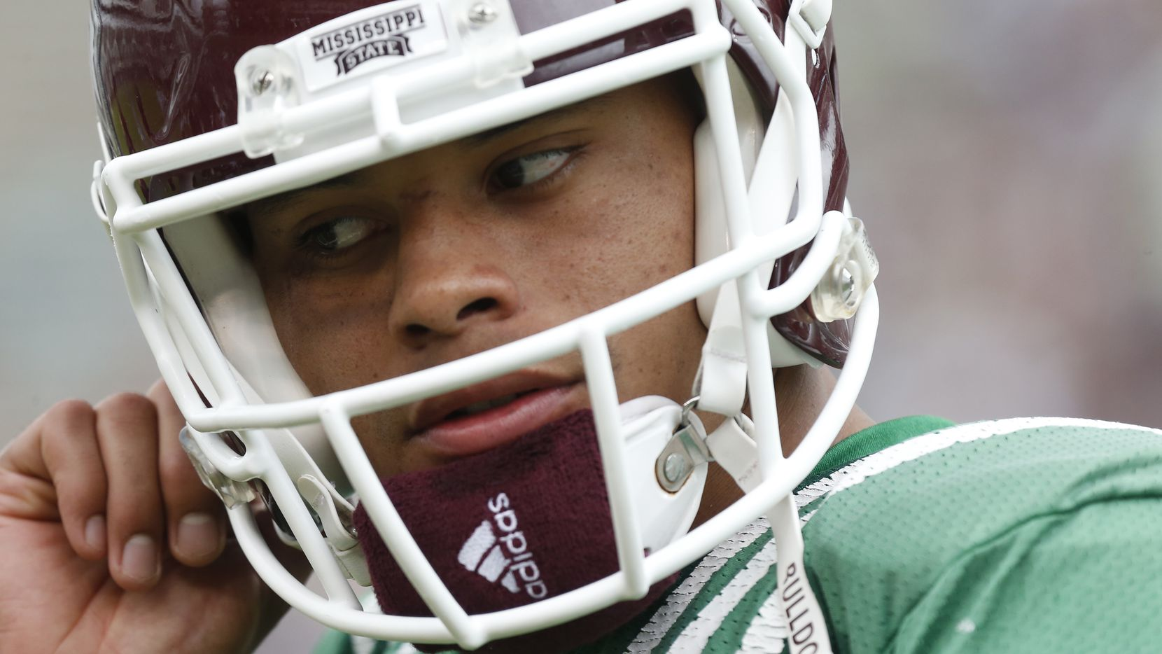 Mississippi State Maroon quarterback Dak Prescott removes his helmet after playing against the White team during their spring NCAA college football spring game, Saturday, April 18, 2015, in Starkville, Miss. (AP Photo/Rogelio V. Solis)