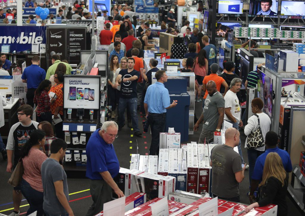 People look at merchandise while holiday shopping at Best Buy on Thursday, Nov. 26, 2015, in Panama City, Fla.