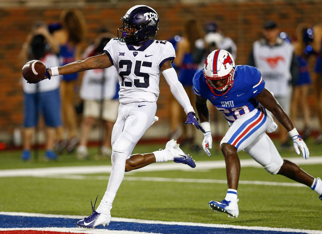 TCU wide receiver KaVontae Turpin (25) runs for a touchdown after a catch past SMU linebacker Jimmy Phillips Jr. (24) during the fourth quarter of an NCAA college football game Friday, Sept. 7, 2018, in Dallas. TCU won 42-12. (AP Photo/Jim Cowsert)