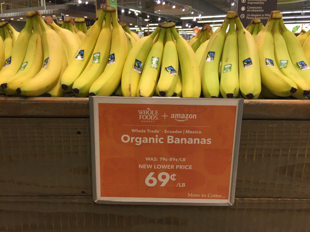 Whole Foods + Amazon price tag on organic bananas at the Whole Foods Market in Dallas on Park Lane.