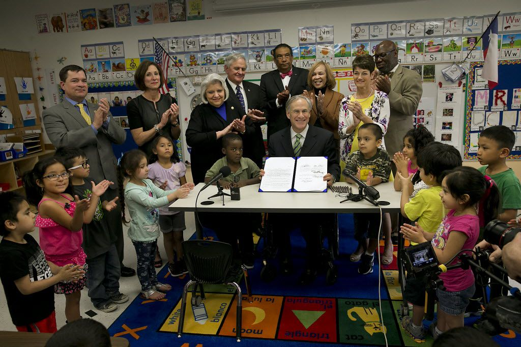 """Texas Gov. Greg Abbott poses for a photo after signing into law a pre-K boost that was among his top campaign promises but has underwhelmed educators in Austin. Abbott's cornerstone education plan that tea party activists rebuked as """"ungodly"""" and Democrats bemoaned as meager finally doled out $116 million this week, but schools are getting only half as much money as what was teased."""