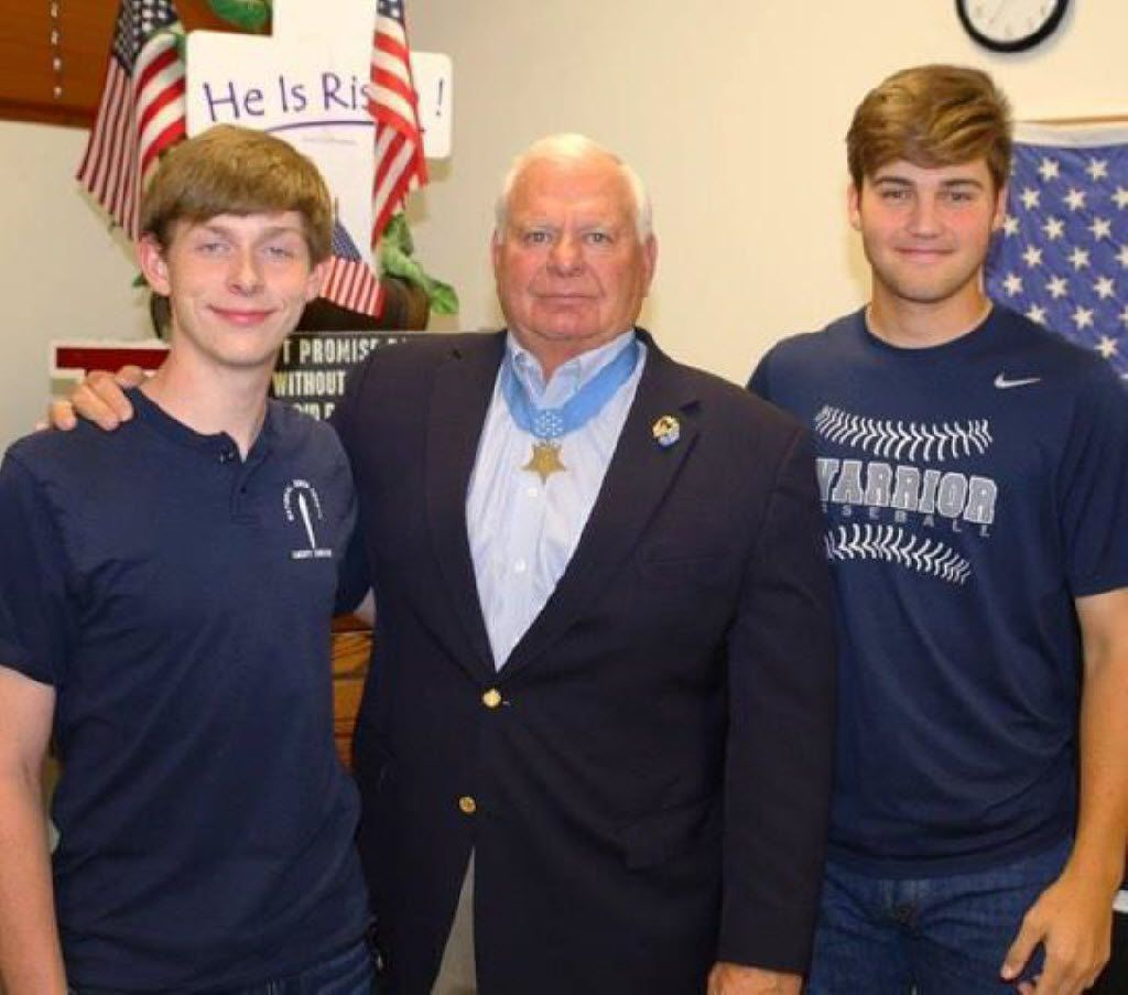 Medal of Honor recipient Lt. Michael E. Thornton, with Liberty Christian  students Henry Harshfield (left) and Brayden Dragoo in 2016, will speak at the Friends of Freedom dinner.