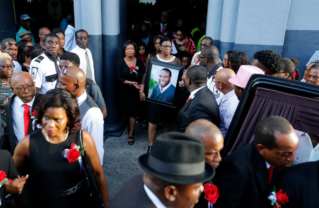Allison Jean exits the church as pallbearers put Botham Shem Jean in the hearse during the funeral at Minor Basilica of the Immaculate Conception in Castries, St. Lucia on Monday, September 24, 2018. Jean was shot and killed in his apartment by off duty Dallas police officer Amber Guyger. (Vernon Bryant/The Dallas Morning News)