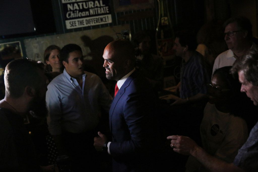 Colin Allred greets supporters after speaking during an election night party.