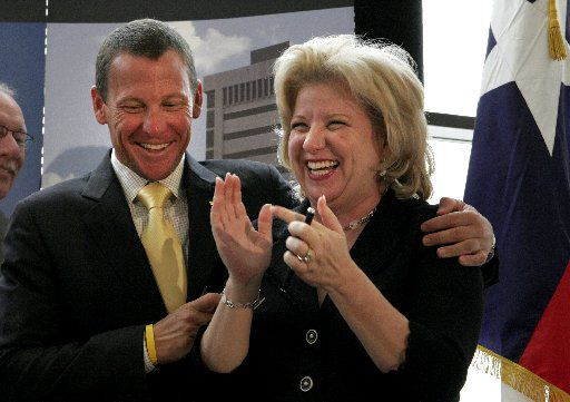 Seven-time Tour de France champion and cancer survivor Lance Armstrong and Texas Sen. Jane Nelson celebrated after then-Gov. Rick Perry signed a bill establishing Texas' unique, state-funded cancer-fighting effort during a ceremony at UT-Southwestern Medical Center in Dallas in June 2007.