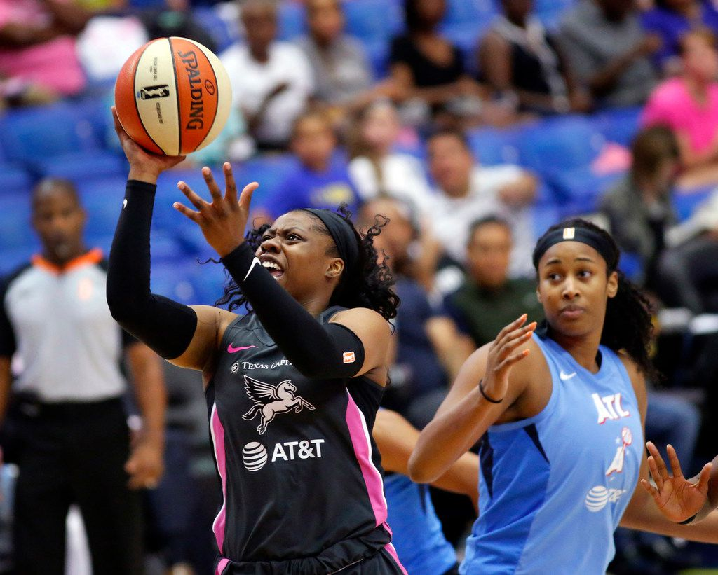 Dallas Wings guard Arike Ogunbowale (24) drives through the Atlanta Dream defense for a first quarter shot at College Park Center in Arlington, Texas, Sunday, August 25, 2019. (Tom Fox/The Dallas Morning News)