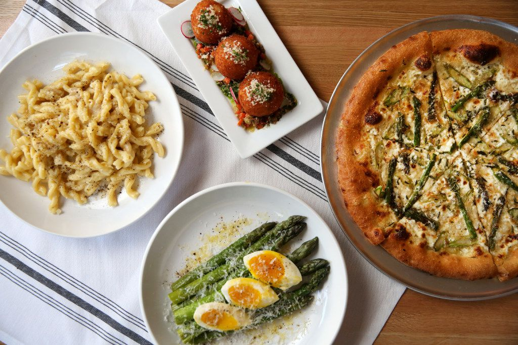 A selection of dishes at Piattello Italian Kitchen: (clockwise from left: strozzapreti cacio e pepe; arancini with caponata; pizza primavera; asparagus milanese  (Rose Baca/The Dallas Morning News