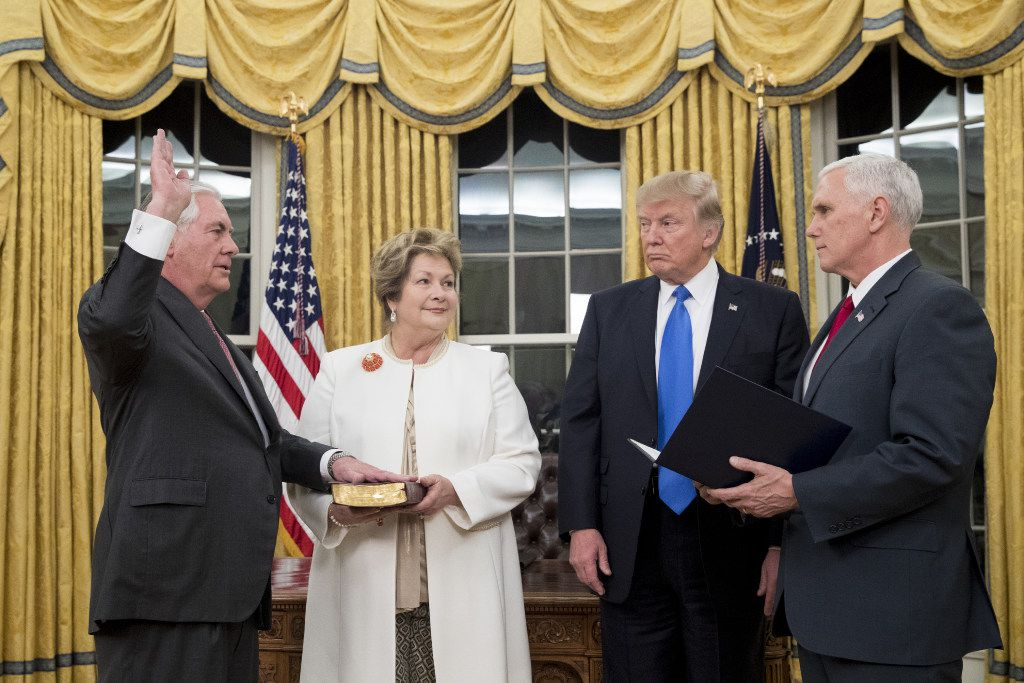 President Donald Trump watches as Rex Tillerson, accompanied by wife Renda St. Clair, is sworn in as the 69th secretary of state by Vice President Mike Pence in the Oval Office of the White House on February 1. (Michael Reynolds-Pool/Getty Images)