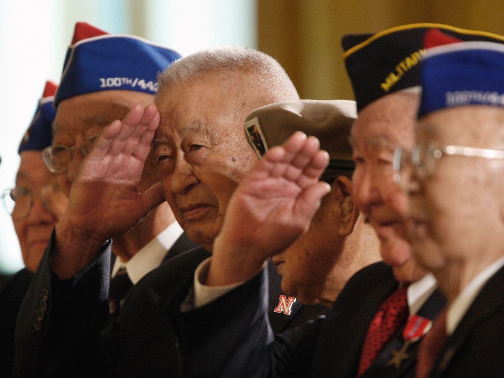 Members of the famed 442nd Regimental Combat Team of the United States Army, a unit composed of mostly Japanese Americans who fought in Europe salute President Bush, Thursday, May 1, 2008, in the East Room of the White House in Washington, during a ceremony celebrating Asian Pacific American Heritage Month.