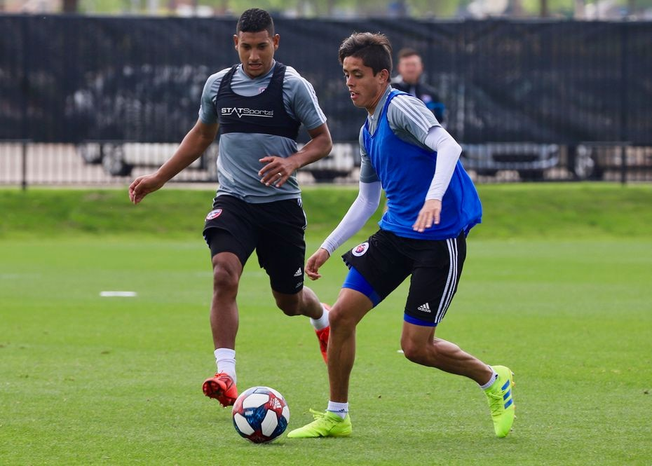 Arturo Rodriguez dribbles under pressure from Bryan Acosta while taking part in FC Dallas training.