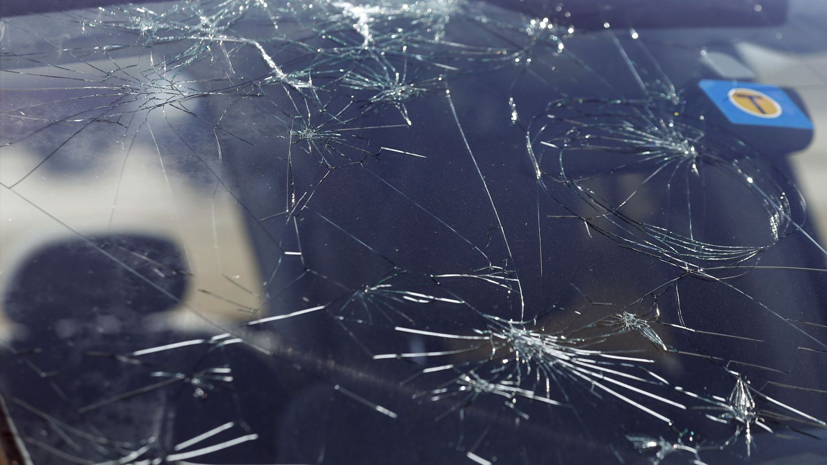 The windshield of a truck in the parking lot of Cottonwood Creek Church in Allen was damaged by hail that blew in Sunday.
