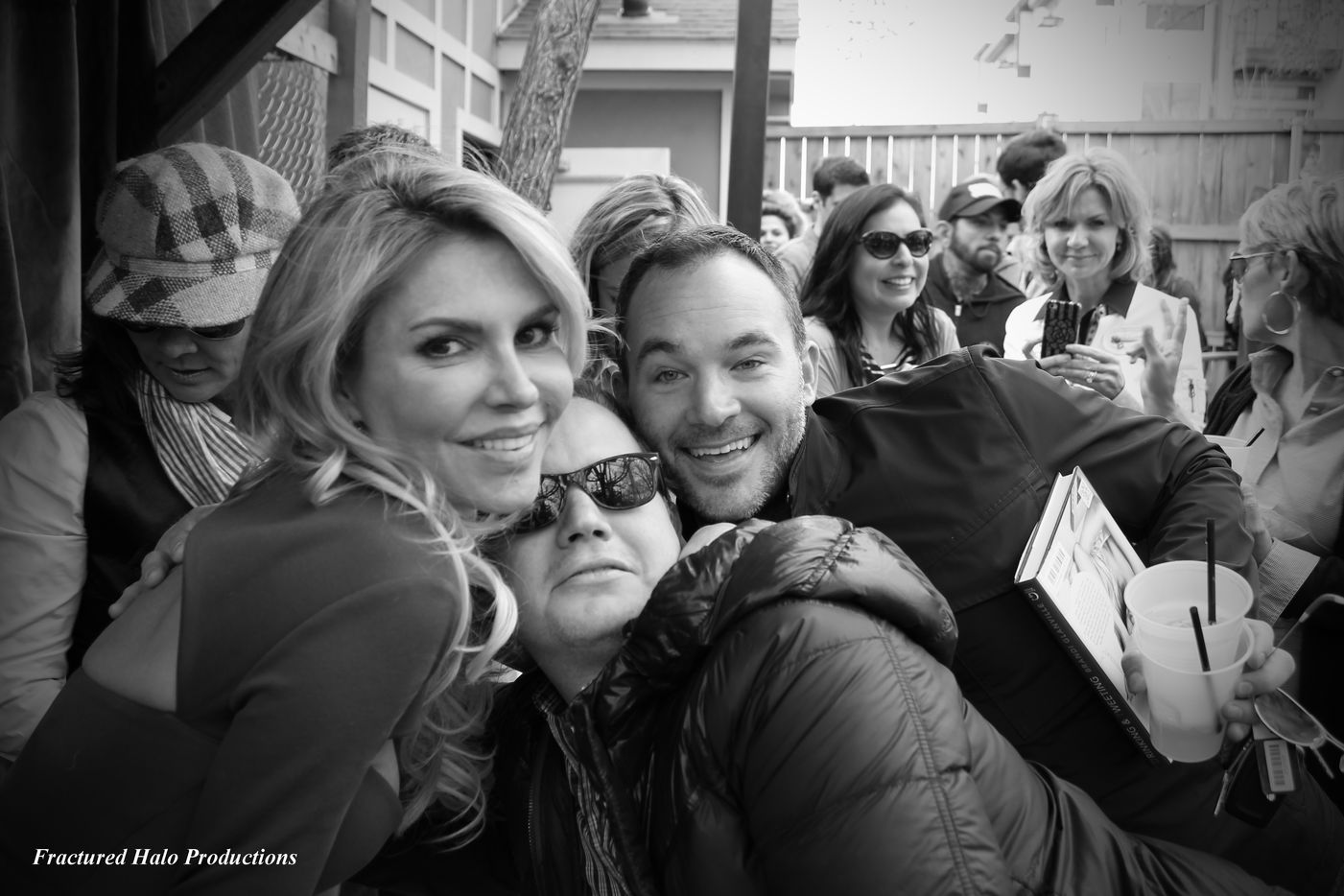 Reality star Brandi Glanville poses with fans during a book signing at the Grapevine Bar.