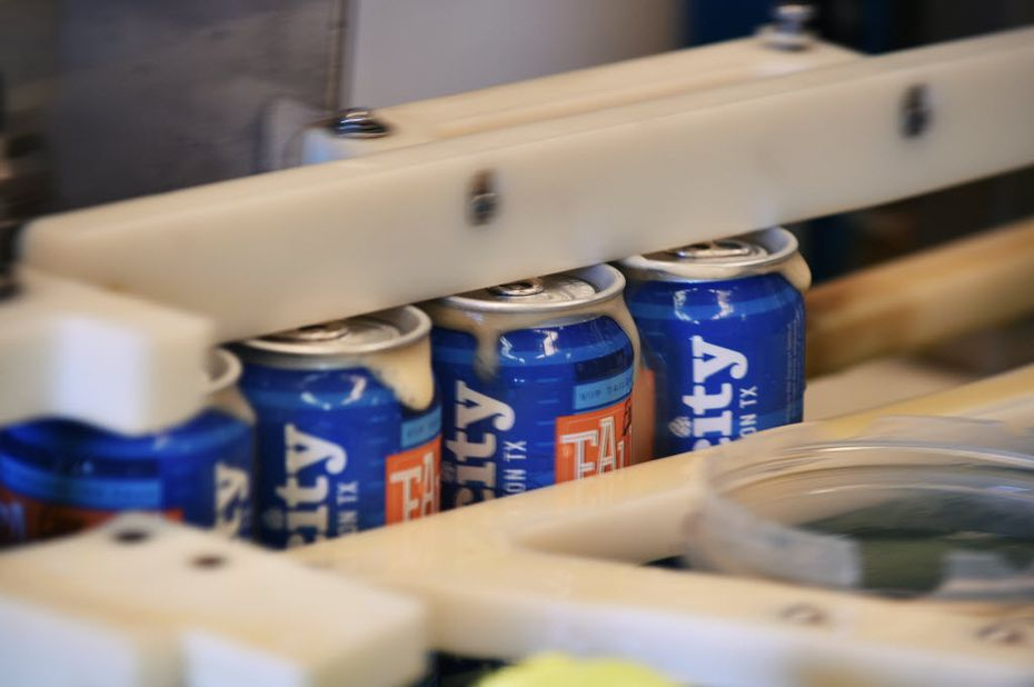 "Cans move through the canning line at Audacity Brew House as they produce their ""Free Fallin' Oktoberfest"" fall seasonal beer. Some brewers prefer cans to bottles because they keep light and oxygen out."